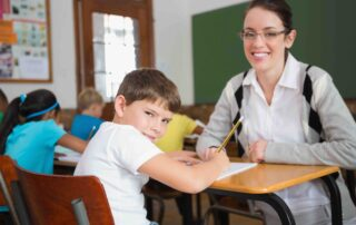 Happy Successful Male Student with Smiling Female Teacher